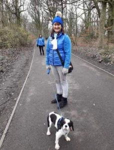 Bailey with his foster mum walking in the woods